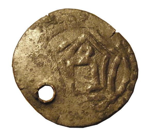 Древняя монета, найденная на месте раскопок